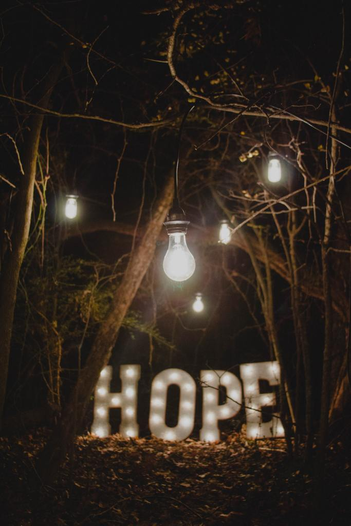 Lit Hope sign in the woods